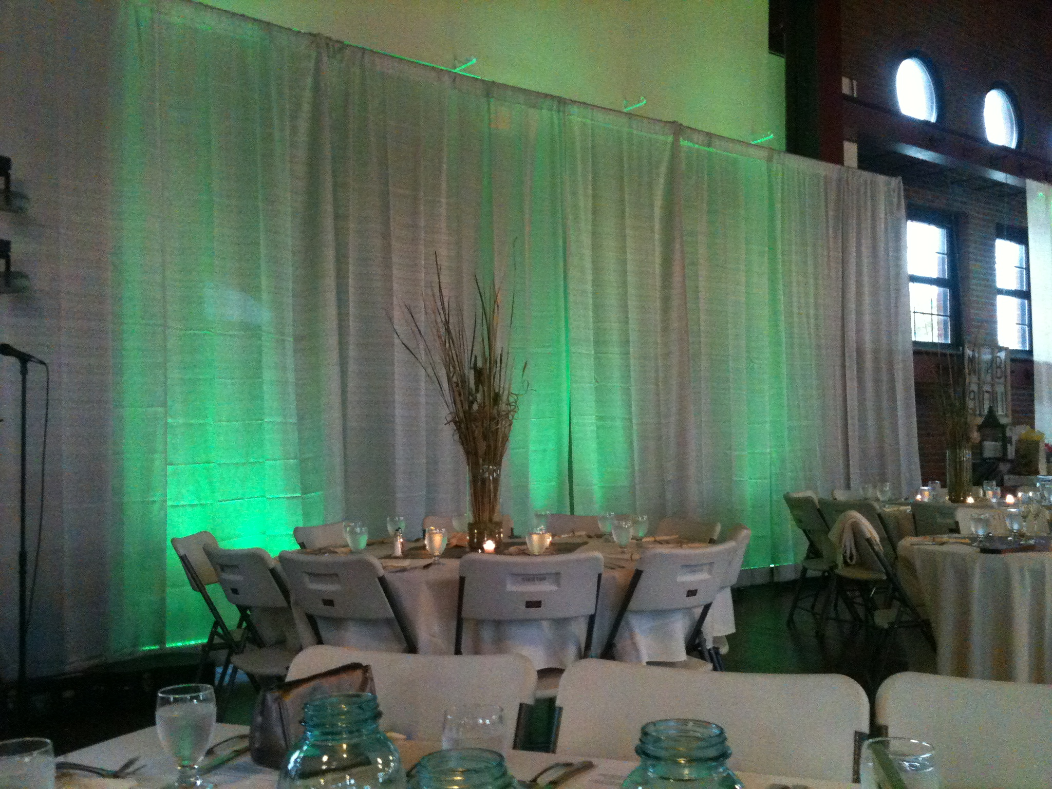 Central illinois wedding reception rentals services drape with teal uplights at artisans bldg junglespirit Image collections